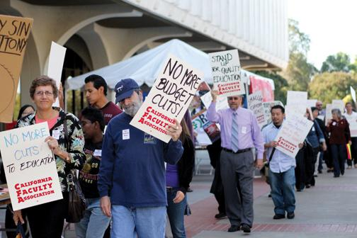 Faculty protest budget cuts in 2012 on the North Library Walkway. File photo.
