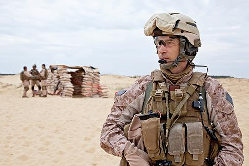 American soldier stands in the sun