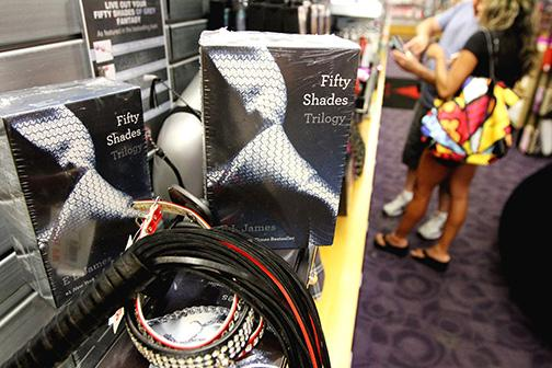 """A couple browses adult toys near the """"50 Shades of Grey"""" trilogy area at the Hustler Hollywood, July 30, 2012, in South Florida. Hustler and other erotica shops have seen an increase in sales of items talked about in the book. Also, the customers coming in aren't the """"regulars"""" but shy people looking to venture into a new territory. ()"""