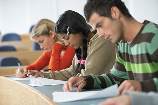 Three Students Taking a Test