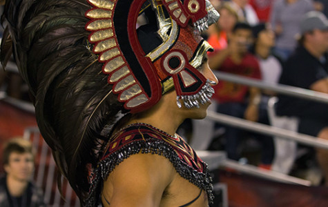 Aztec Warrior mascot at a sports event.