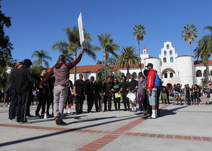 Males participating in the protest were invited to the center of the circle as the group chanted their support.