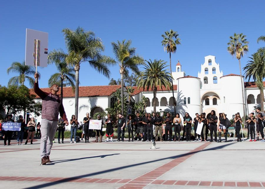 A protester's speech to the group is met with cheers and applause.