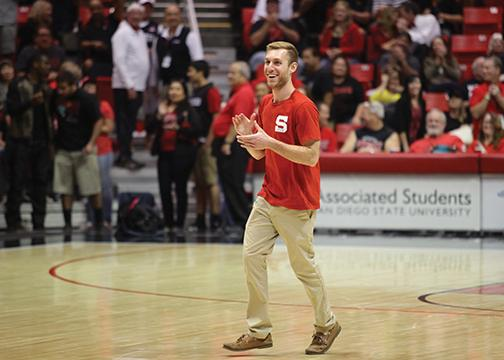 Student sinks lucky half-court shot