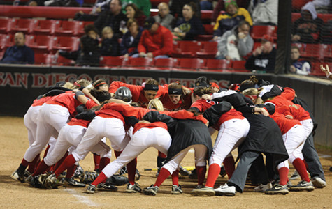 SDSU Softball team huddles at softball stadium