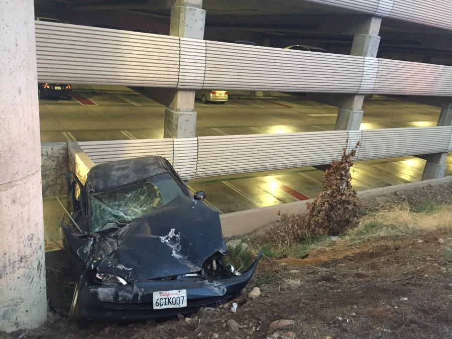 No+one+seriously+injured+after+car+skids+off+road+into+SDSU+parking+structure