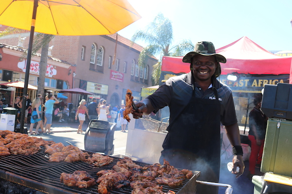 Flavors of East Africa serves their signature meals to festival goers.