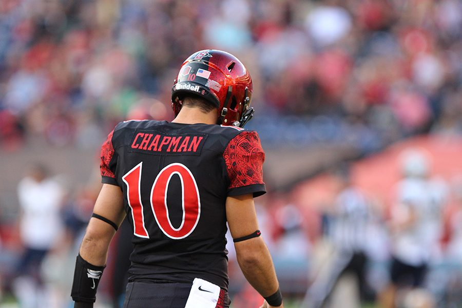 Redshirt sophomore quarterback Christian Chapman walks off the field after a failed play.