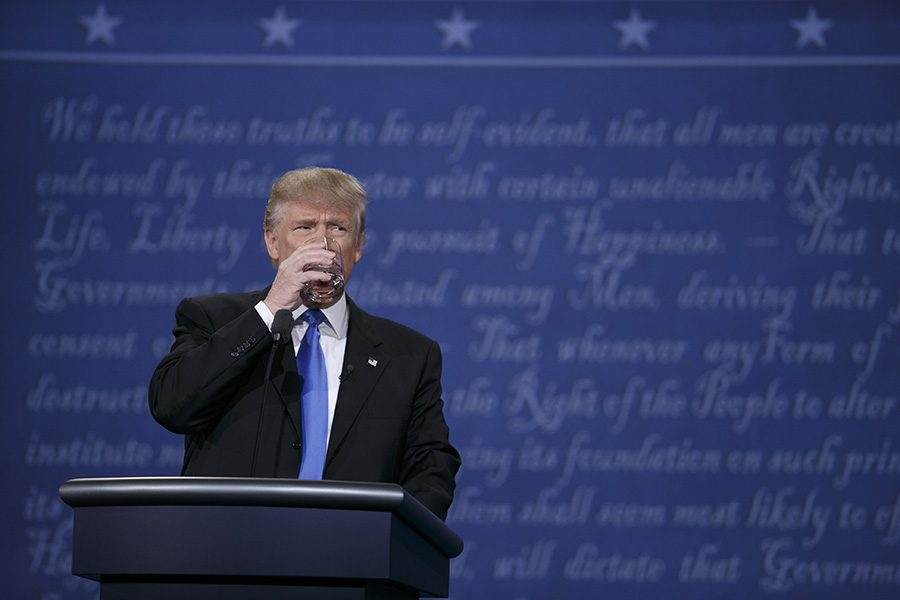 Trump takes a drink during the first 2016 presidential debate.