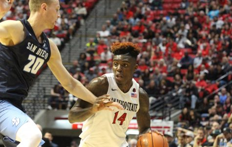 Redshirt sophomore forward Zylan Cheatham attacks the basket against University of San Diego.