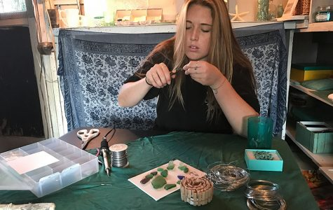 Student sells sea glass by the sea shore