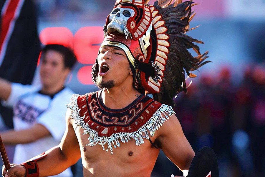 A man portrays the Aztec Warrior mascot at a sporting event in spring 2017.