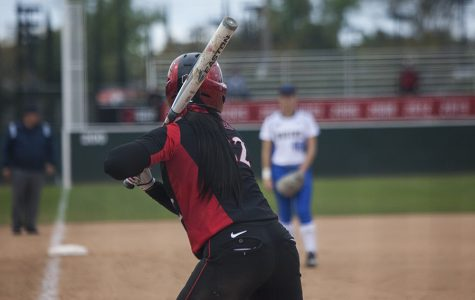 Freshman utility player Kiera Wriight chokes up on the bat against UCLA on Feb. 10.