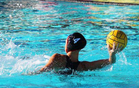 Aztecs swim to nail-biting victories
