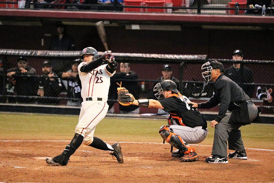 Sophomore catcher Dean Nevarez makes contact against a University of Pacific pitcher.