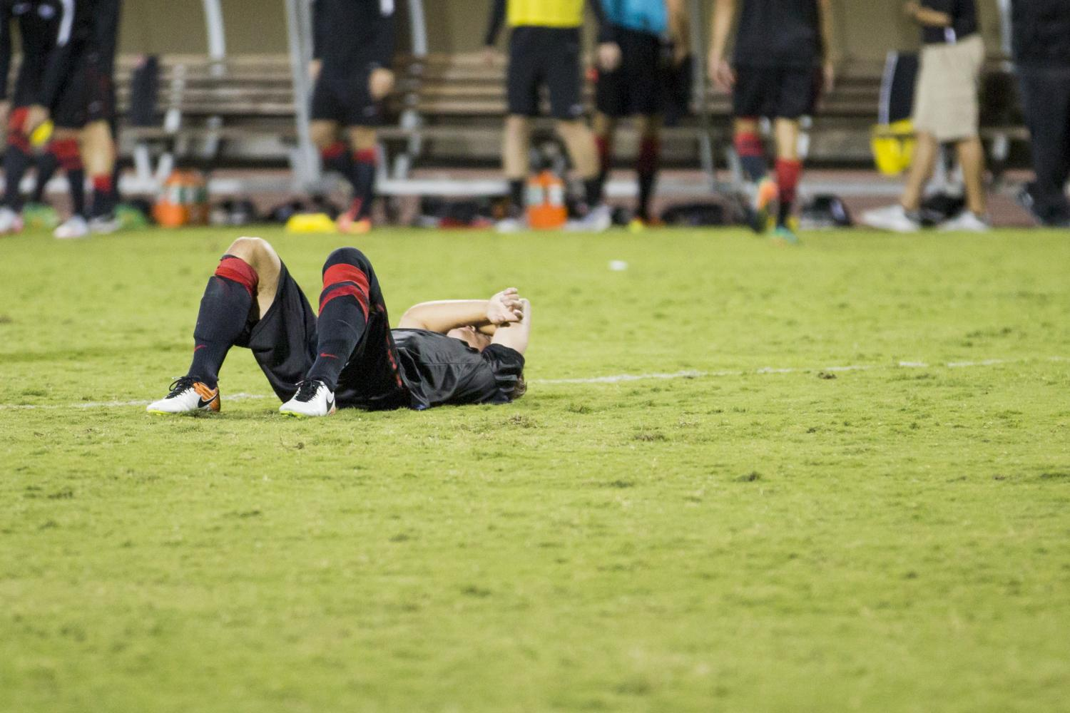 An SDSU player reacts to a loss during the 2016 season.
