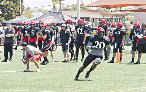 SDSU senior running back Rashaad Penny runs a route during the team's practice at Miramar MCAS.