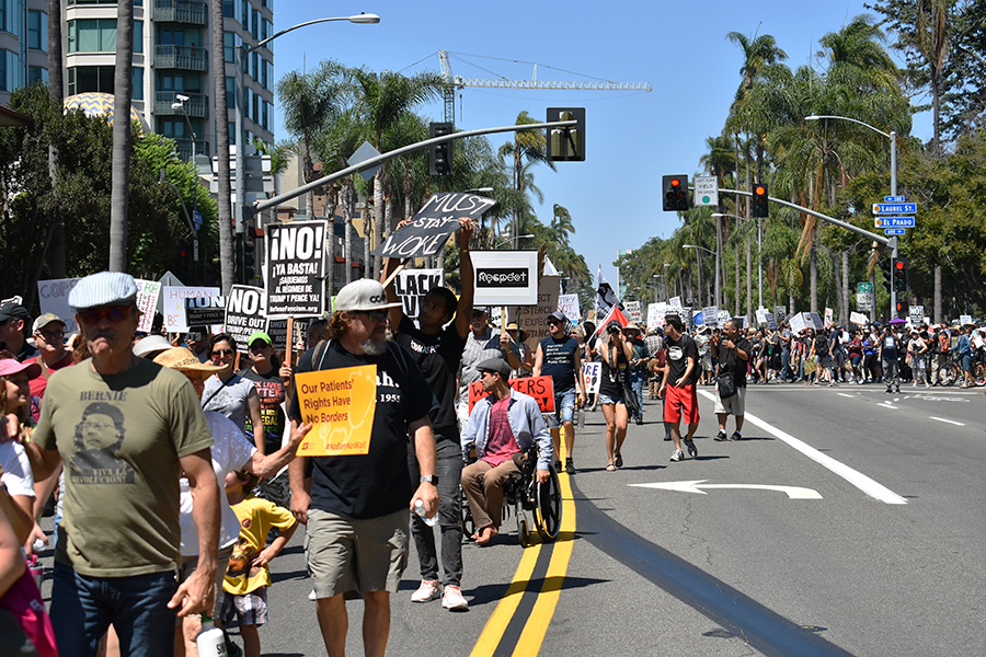 Protesters march from Balboa Park to Horton Plaza as part of a