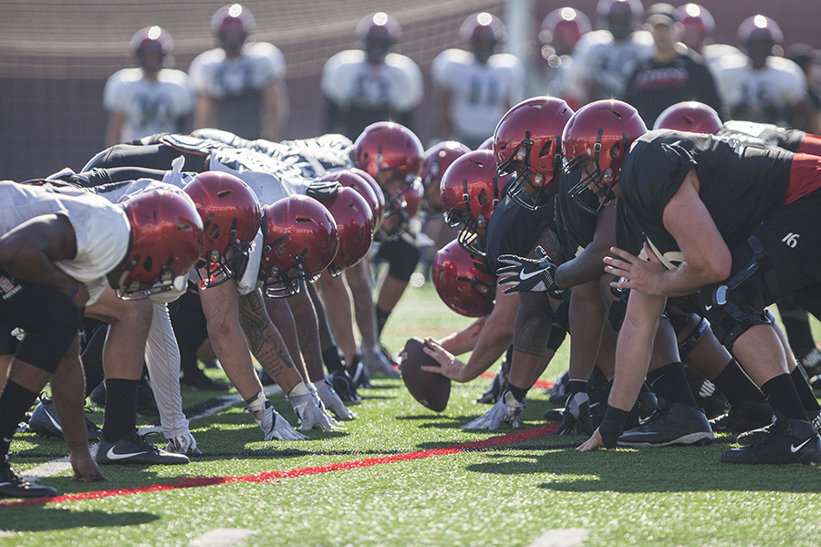 SDSU+football+players+prepare+for+a+snap+during+a+2017+practice.