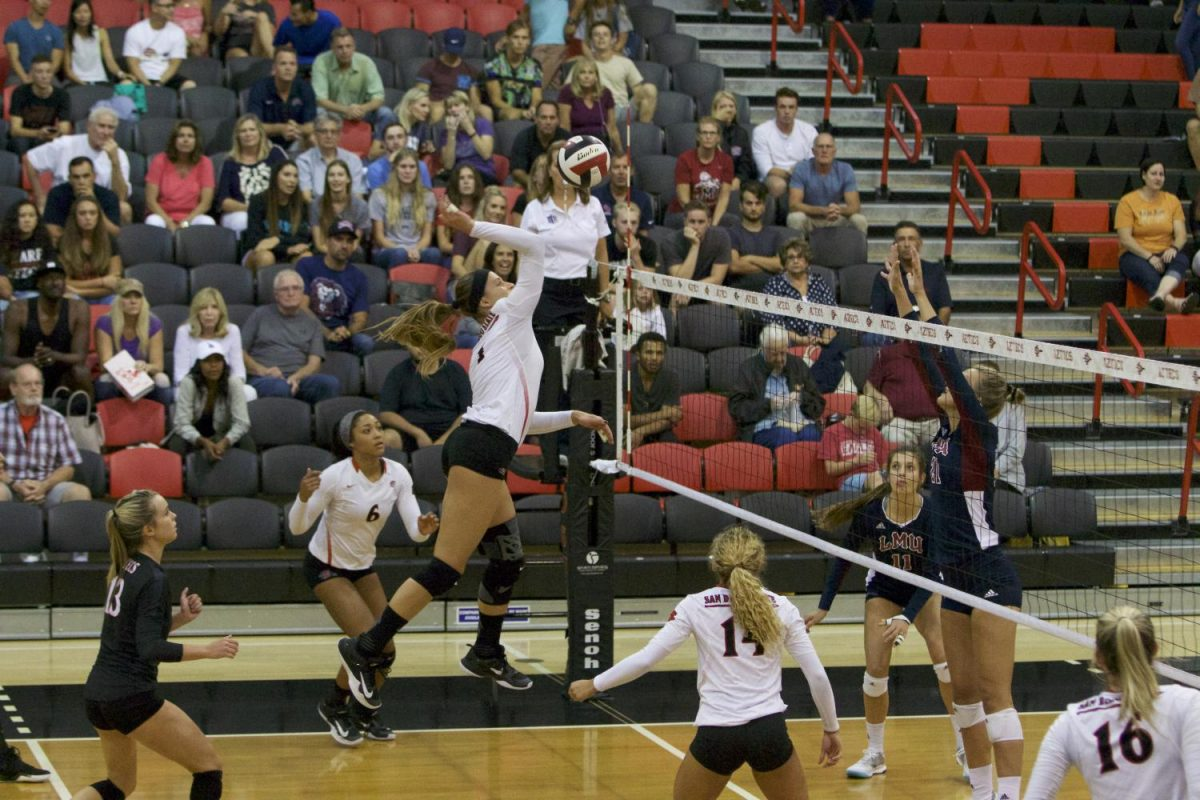 Junior outside hitter Alexandra Psoma rises for a spike during SDSUs match against Loyola Marymount.