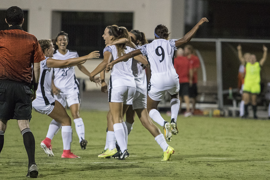 Senior+midfielder+Angela+Mitchell+celebrates+with+several+other+SDSU+players+after+a+goal+over+USD.