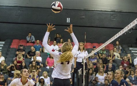 Senior outside hitter Alexis Cage sets up a teammate during SDSU's match against Loyola Marymount.