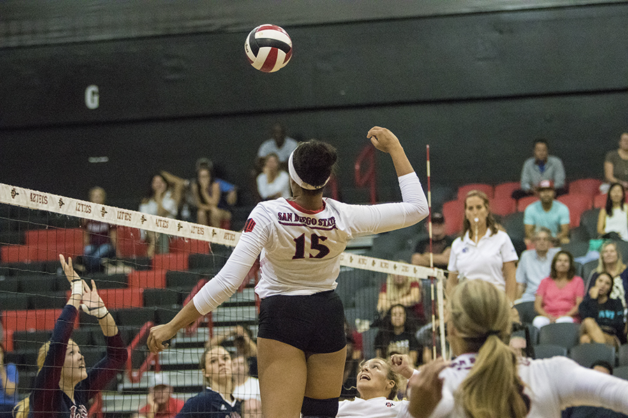 SDSU+junior+middle+blocker+Deja+Harris+sets+up+for+a+spike+against+Loyola+Marymount.