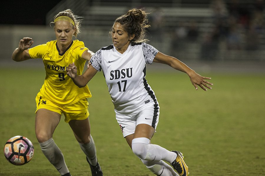 Senior forward Aaliyah Utush wrestles with Wyoming junior defender Alyssa Murray during SDSU's 2-1 win over the Cowgirls.