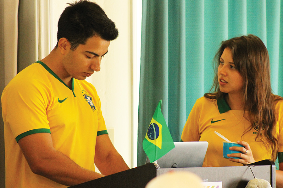 International business junior Matheus Peronti and economics junior Renata Valente speaking at the Brazilian themed International Coffee Hour.