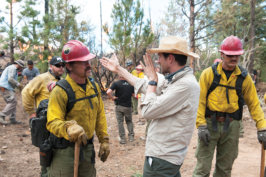 Director Joseph Kosinski speaks with actor Josh Brolin while on the set of Columbia Pictures'