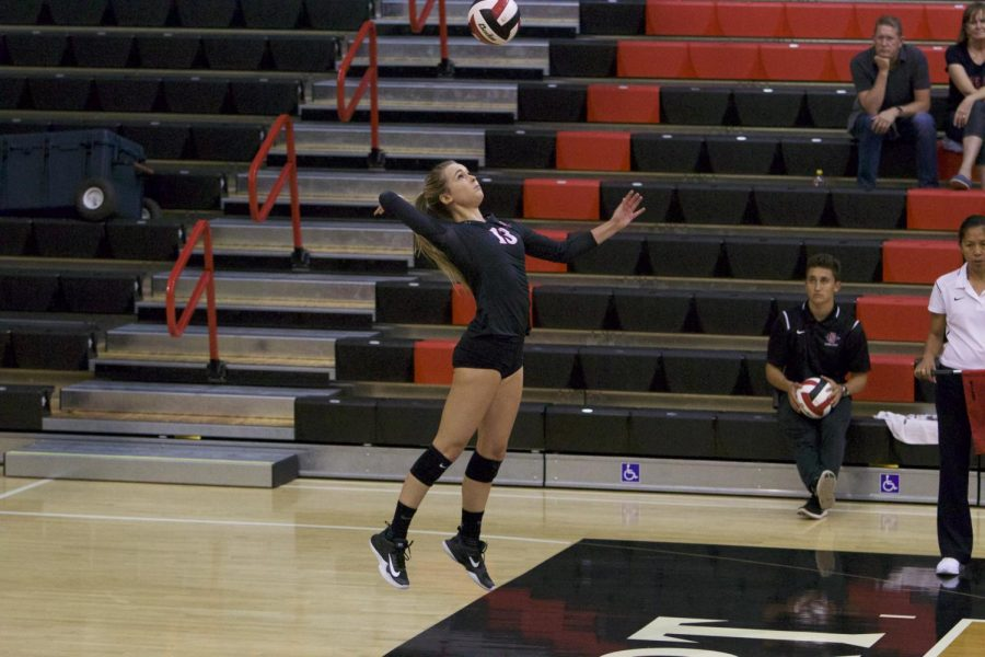 Senior+libero+Devyn+Pritchard+rises+for+a+serve+during+SDSU%27s+loss+to+Loyola+Marymount+on+Sept.+8.