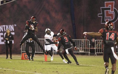 Senior safety Kameron Kelly intercepts an NIU pass at the goal line during the fourth quarter of SDSU's 34-28 win.