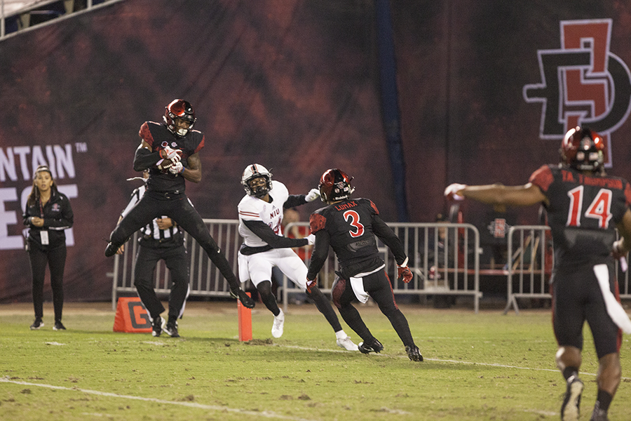 Senior+safety+Kameron+Kelly+intercepts+an+NIU+pass+at+the+goal+line+during+the+fourth+quarter+of+SDSU%27s+34-28+win.