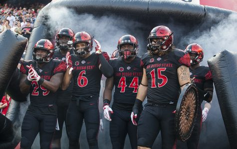 Sophomore running back Juwan Washington, senior wide receiver Mikah Holder, sophomore linebacker Kyavha Tezino and senior fullback Nick Bawden lead SDSU onto the field before its opening game win over UC Davis Sept. 2.
