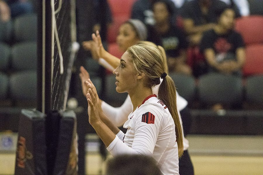 Senior+hitter+Alexis+Cage+stands+ready+at+the+net+during+SDSU%27s+loss+to+Loyola+Marymount+on+Sept.+8.