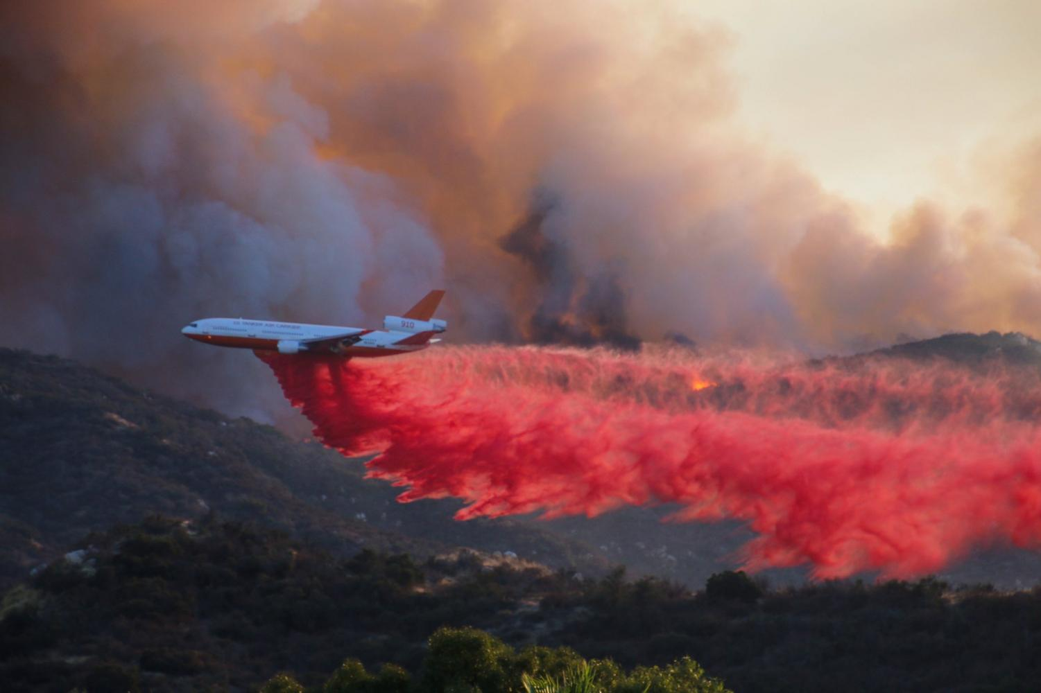 An aircraft drops retardant on a wildfire in Wildomar, Oct. 26. Photo courtesy of Cleveland National Forest's Twitter page.