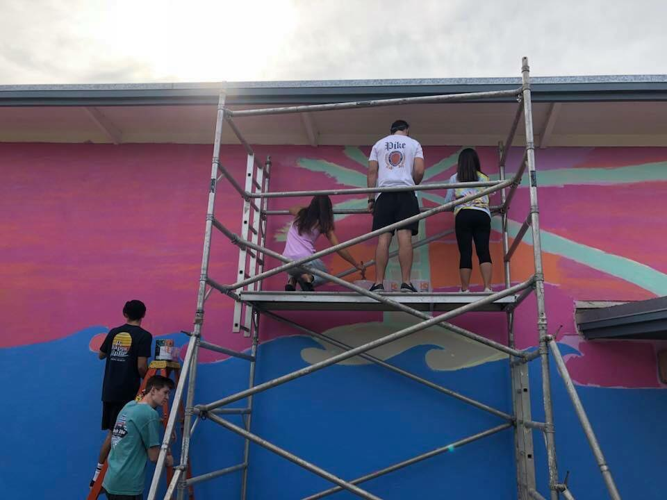Members of Pi Kappa Alpha and Delta Gamma paint a mural at Clay Elementary School in San Diego on Nov. 14-16.