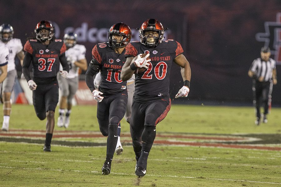Rashaad Penny runs  the ball in the Aztecs 42-23 victory over Nevada on Nov. 18.
