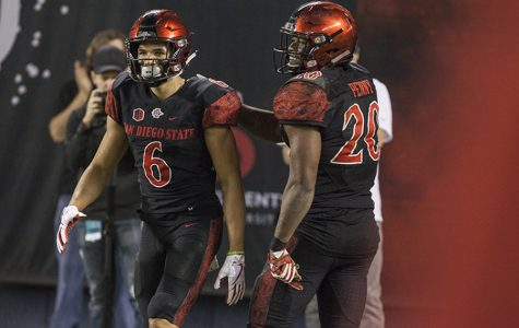 Senior running back Rashaad Penny (20) pats senior wide receiver Mikah Holder (6) on the back during the Aztecs 42-23 victory over Nevada on Nov. 18 at SDCCU Stadium