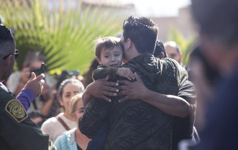 "Families share tears, hugs and words in ""Opening the Door of Hope"" event at Friendship Park"