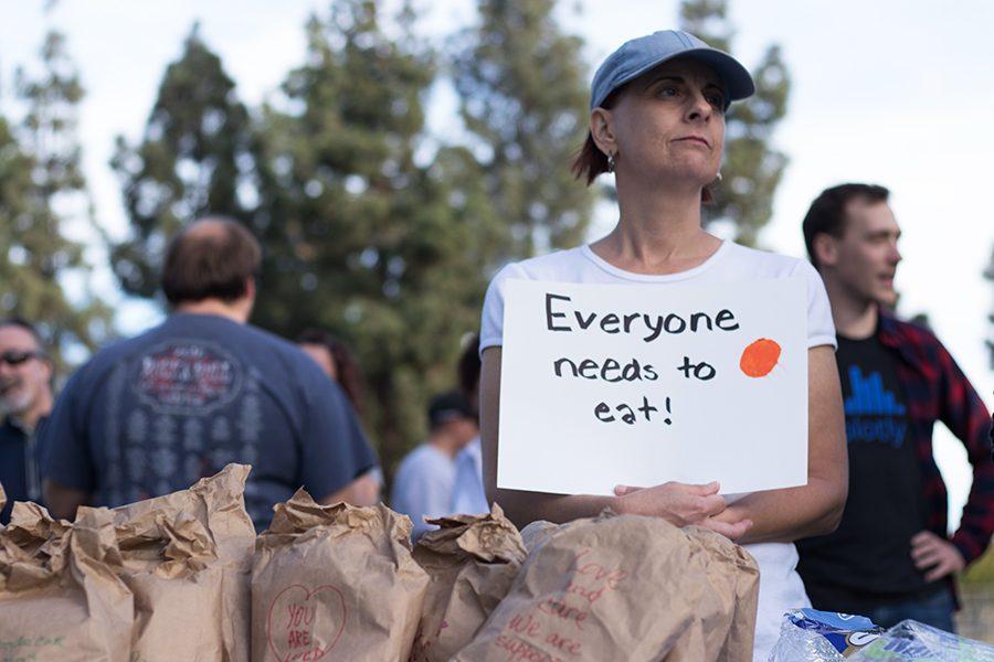Community member Nicole Dangelo protests El Cajon's ordinance banning