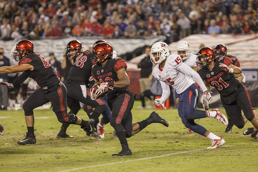 Senior+running+back+Rashaad+Penny+blows+by+a+Bulldog+defender+during+SDSU%27s+3-27+loss+to+Fresno+State+on+Oct.+21.