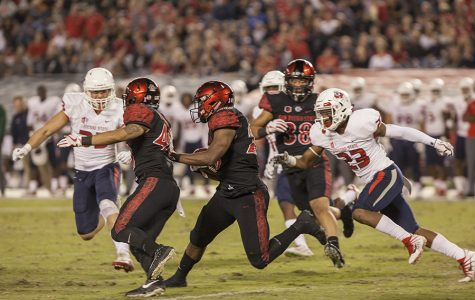 Senior running back Rashaad Penny carries the ball during SDSU's 27-3 loss to Fresno on Oct. 21.