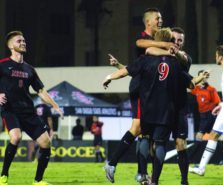 The Aztecs celebrate the third goal of their game against UCLA, shot by senior Winston Sorhaitz with Jeroen Meefout on the assist at the SDSU Sports Deck on Nov. 11, 2017.