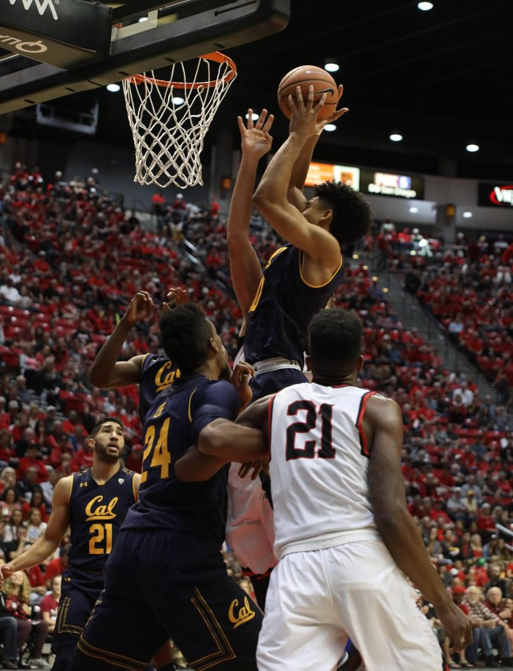 Malik Pope (21) looks on as Cal freshman forward Justice Sueing attempts a shot in the Aztecs 63-62 loss at Viejas Arena on Dec. 9