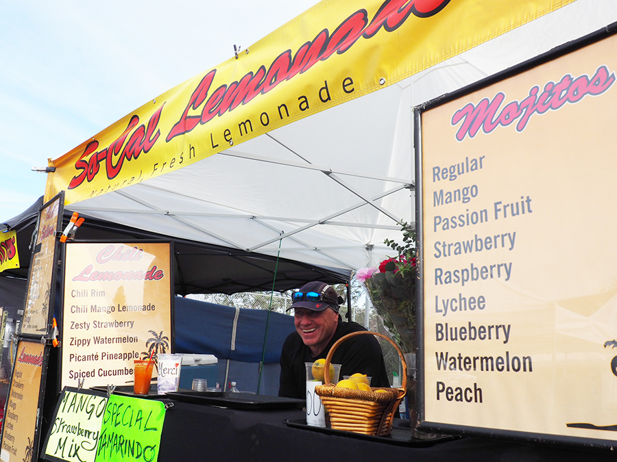 Monsieur Jean-Michel smiles at his lemonade stand at the La Jolla farmer's market Dec. 10.