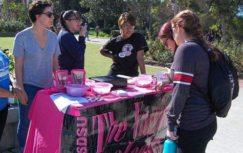 """The Vagina Monologues"" producer Laura Horton, Co-Director Ella Castillo and cast member Elvan Guzman table for the upcoming performances on campus."