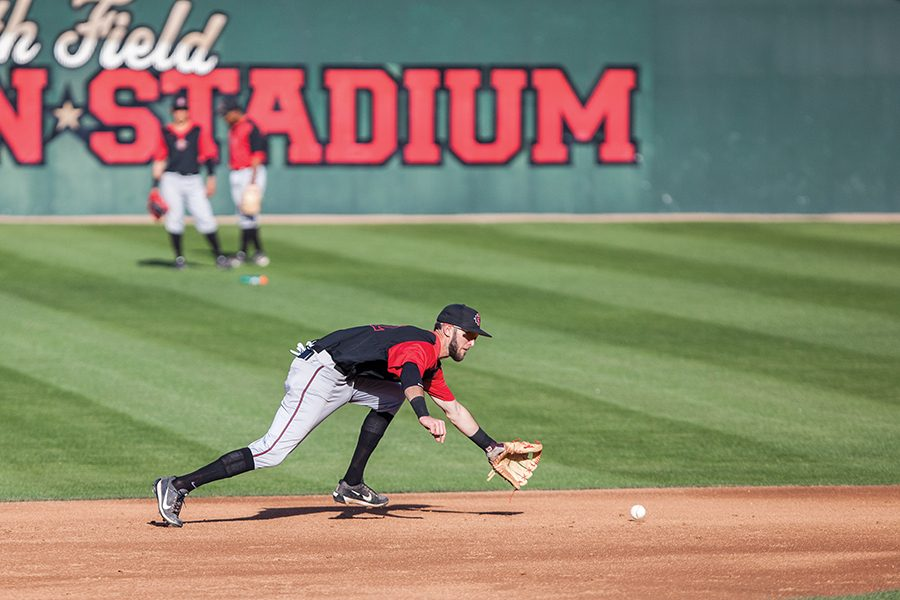 Aztecs+junior+infielder+David+Hensley+goes+for+a+ground+ball+during+baseball+practice+on+Jan.+26.