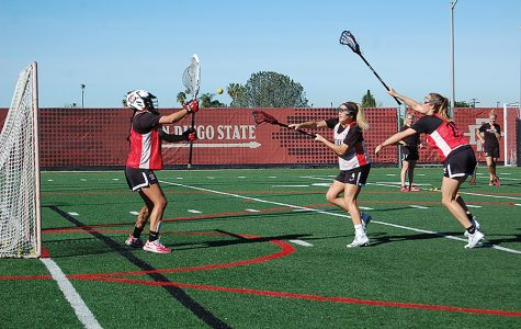 Sophomore midfielder Ryli Quin takes a shot during a lacrosse practice scrimmage on Jan. 29.