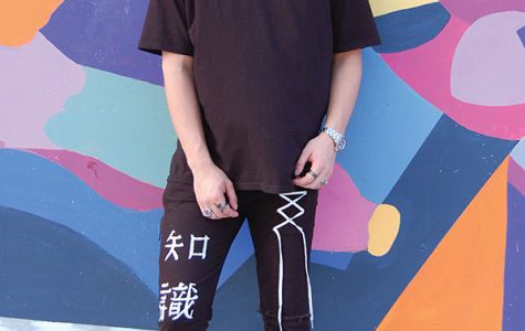 Marketing senior Noah Chen models his own fashion line Koi Clothing.